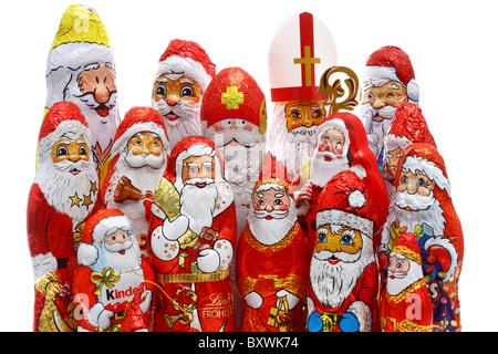 Chocolate Santa clauses. - Stock Photo