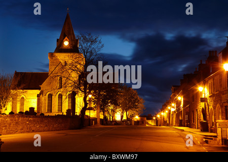 Dornoch Cathedral, floodlit at night (built in the 13th century), and Hight Street, Dornoch, Highlands, Scotland, - Stock Photo
