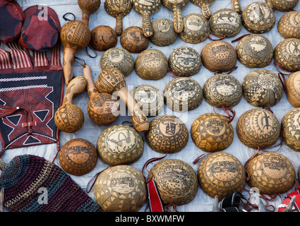 At the biannual Salon International de l'Artisanat de Ouagadougou SIAO in Burkina Faso vendors sell carved calabashes and gourds