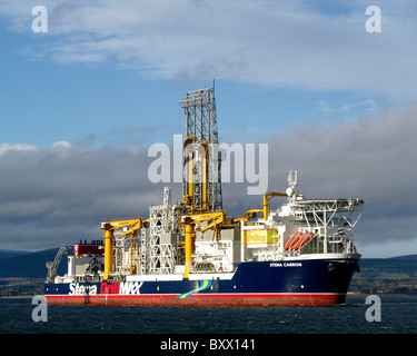 The Drillship Stena Carron leaving the Cromarty Firth, on  route to drill deepwater oil wells in the waters near Greenland. Stock Photo