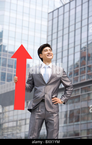 Chinese businessman with a red arrow - Stock Photo