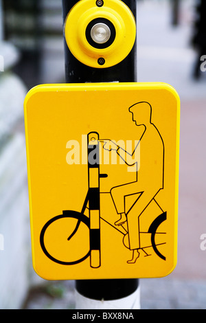 Road crossing Amsterdam highlighting cyclist safety - Stock Photo