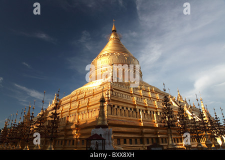 The Shwezigon Pagoda or Shwezigon Paya a Buddhist temple near Nyaung-U near Bagan in Myanamar or Burma in Southeast - Stock Photo