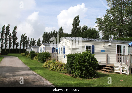 Static caravan holiday home on a woodland caravan park - Stock Photo