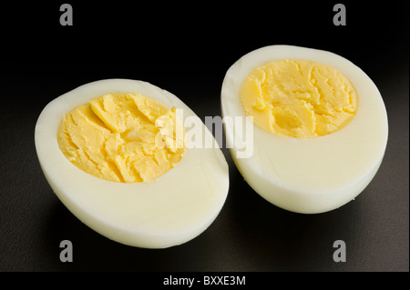 Egg cut in half studio isolated on white background - Stock Photo