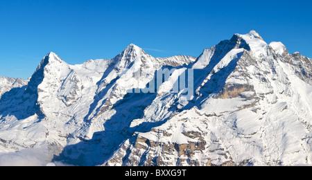 Early evening sunshine over the Eiger, Monch, and Junfrau, Murren, Switzerland - Stock Photo