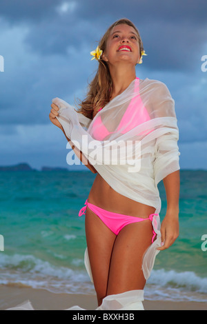 Love of blond teen holding sunglasses