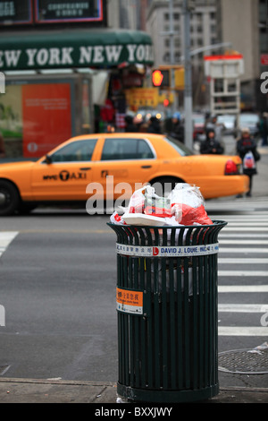 Overflowing street waste container on a street in New York city, 2010 - Stock Photo