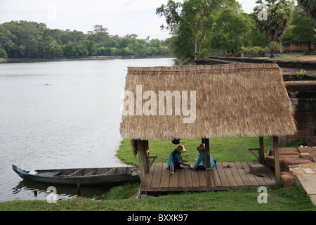 Jetty on the banks of the moat around Angkor Wat, Cambodia - Stock Photo
