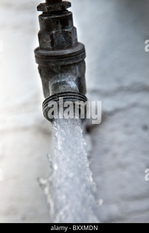 Running Garden Tap. - Stock Photo