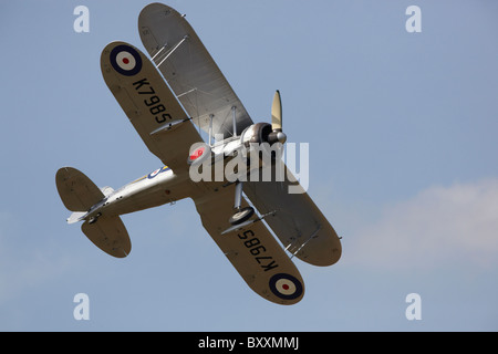 Gloster Gladiator I flying during a display at Duxford, Cambridgeshire, England, UK - Stock Photo