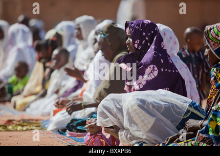 On the morning of Tabaski, men, women, and children alike converge on the great mosque of Djibo in northern Burkina - Stock Photo