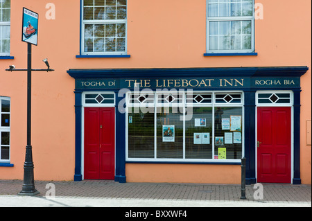 Brightly painted The Lifeboat Inn traditional bar in Courtmacsherry, West Cork, Ireland - Stock Photo