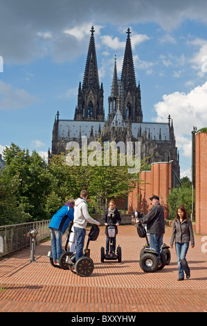 Tourists using Segways on a tour of Cologne, Germany. - Stock Photo