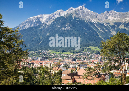 Innsbruck, Austria sits in a valley in front of steep mountains. - Stock Photo