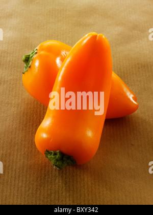 Sweet bite baby orange peppers - Stock Photo