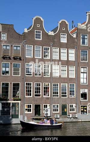 Traditional Dutch houses and canal in Amsterdam, Holland - Stock Photo