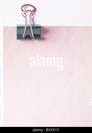 bulldog clip on a piece of paper - Stock Photo