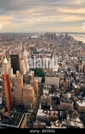 New York City Manhattan sunset skyline aerial view with office building skyscrapers and Hudson River. - Stock Photo