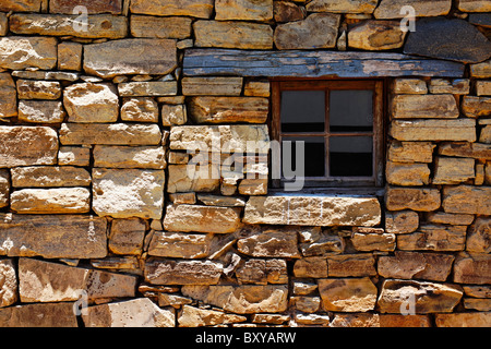 Old dry stone wall with small timber framed window. Fort Nottingham, Midlands, KwaZulu Natal, South Africa. - Stock Photo