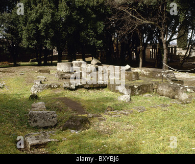 Pompeii. Triangular Forum. Doric temple ruins. Foundations and fragments of the pillar in the temple. Italy. - Stock Photo