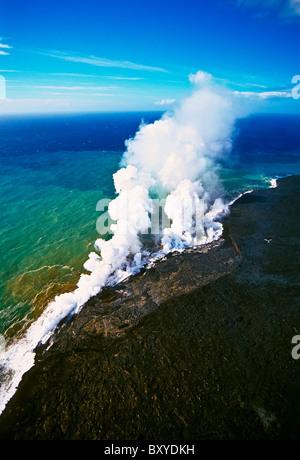 Molten Lava enters cold Ocean, Kilauea Volcano, Big Island, Hawaii, USA - Stock Photo