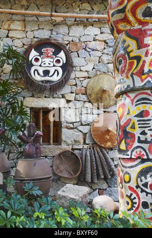 Replica of traditional house of Buyi minority at Folk Culture Village, Shenzhen, Guangdong, China - Stock Photo