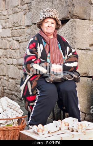 An Irish lady selling eggs at Limerick's Milk market, Republic of Ireland. - Stock Photo