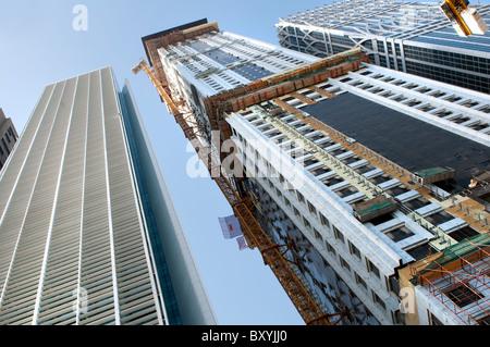 skyscrapers construction site in Dubai - Stock Photo