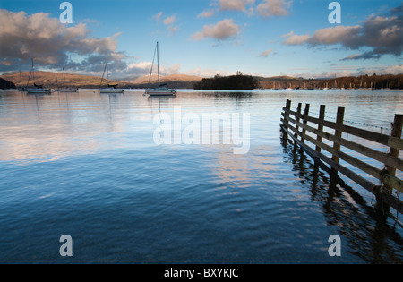 Evening light on a tranquil Lake Windermere in the Lake District, Cumbria England - Stock Photo