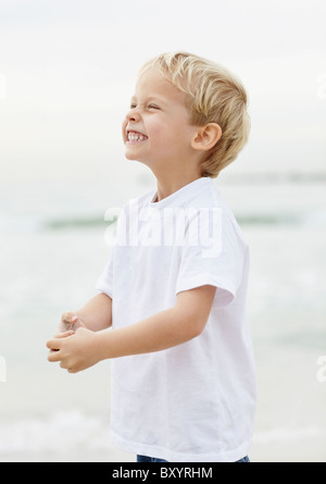 Portrait of boy playing on beach - Stock Photo