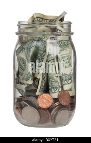 Jar full of money on white background - Stock Photo