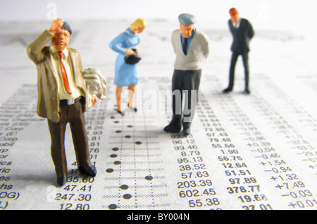 Business figurines on financial figures - Stock Photo