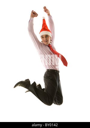 Jumping businessman in santa cap having fun in white background - Stock Photo
