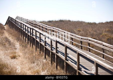 A wooden footbridge - Stock Photo