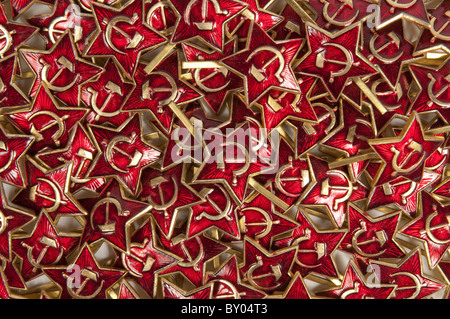 Red star with hammer and sickle cap badges - Stock Photo