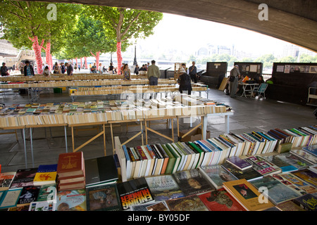 Secondhand book market under Waterloo Bridge outside the South Bank Centre - Stock Photo