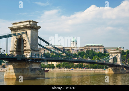 The Chain Bridge, Szechenyi Lanchid, over the river Danube hungarian national gallery above on the hill Budapest - Stock Photo