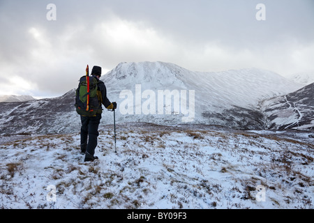 Hill Walker on the Slopes of Stile End Looking Towards Causey Pike in Winter Lake District Cumbria UK - Stock Photo