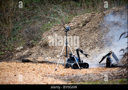 EOD Robot firing Water Jet Disruptor, training for dearming roadside bombs in Afghanistan (Pigstick) - Stock Photo