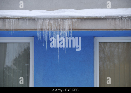 Icicles on a building - Stock Photo