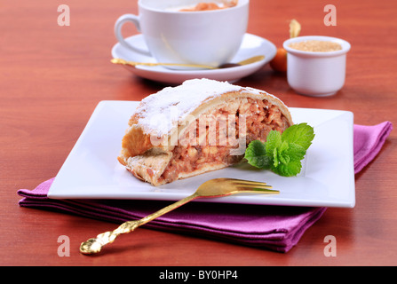 Slice of apple strudel and a cup of coffee - Stock Photo