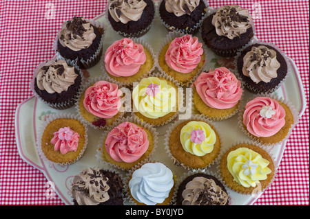 Brightly coloured cup cakes on sale at Farmers Market, County Clare, West of Ireland - Stock Photo