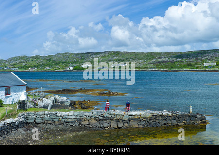 Couple enjoying the view in Connemara National Park, County Galway, Ireland - Stock Photo