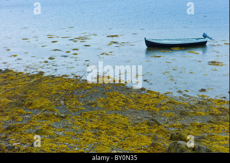 Curragh fishing boat at Fahy Pier near Cleggan, Connemara, County Galway, West Coast of Ireland - Stock Photo