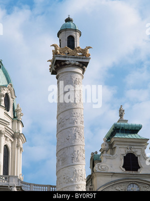 Karlskirche. Column on the right side of the church depicting scenes from the life of St. Charles Borromeo. Vienna. - Stock Photo