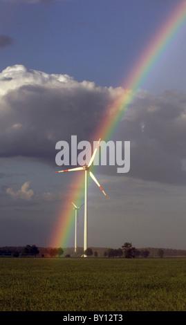 Rainbow over a windmill, Freiwalde, Germany - Stock Photo