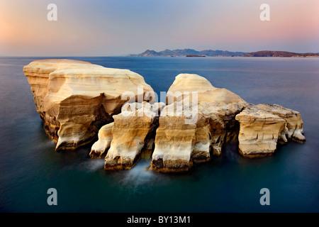 Milos island, volcanic rocks in Sarakiniko beach (slow shutter speed). Cyclades, Aegean sea, Greece. - Stock Photo