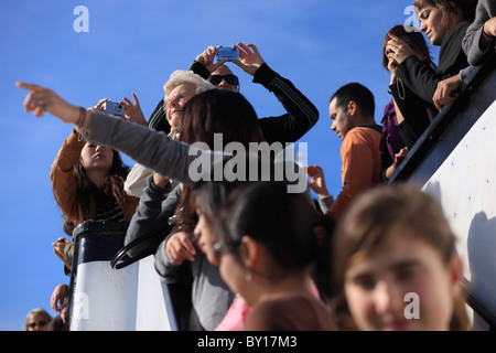 Tourists on the ferry to Liberty Island standing at the rail, New York City, United States of America - Stock Photo