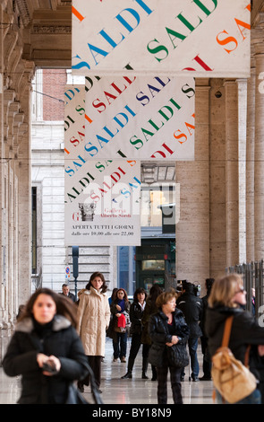 Wintry sales in January, discounts cartels in hight street center of Rome city Italy shopping - Stock Photo